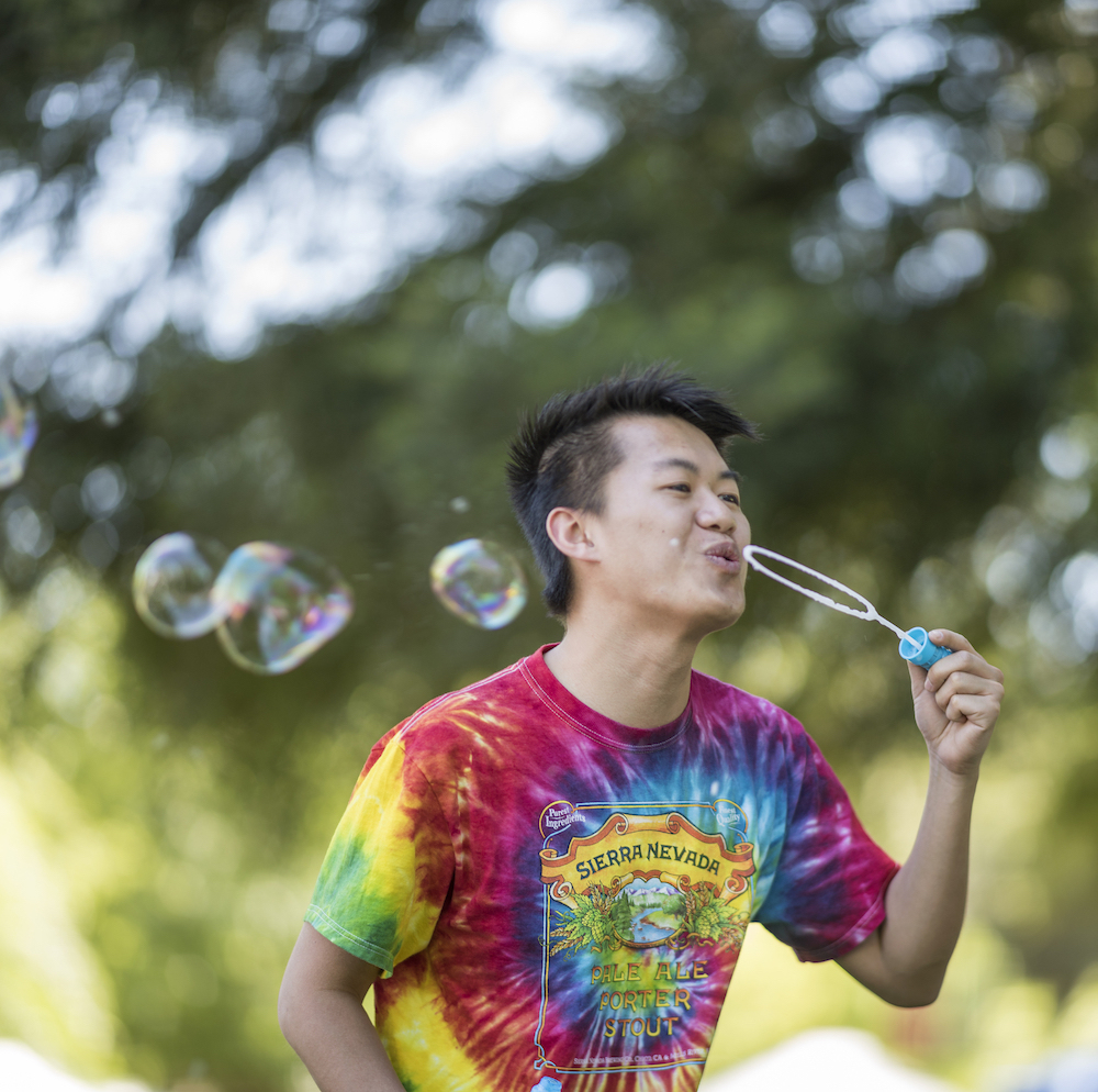 Photo of man blowing bubbles