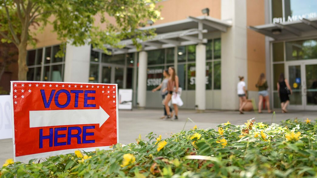 """photo of """"vote here"""" sign"""
