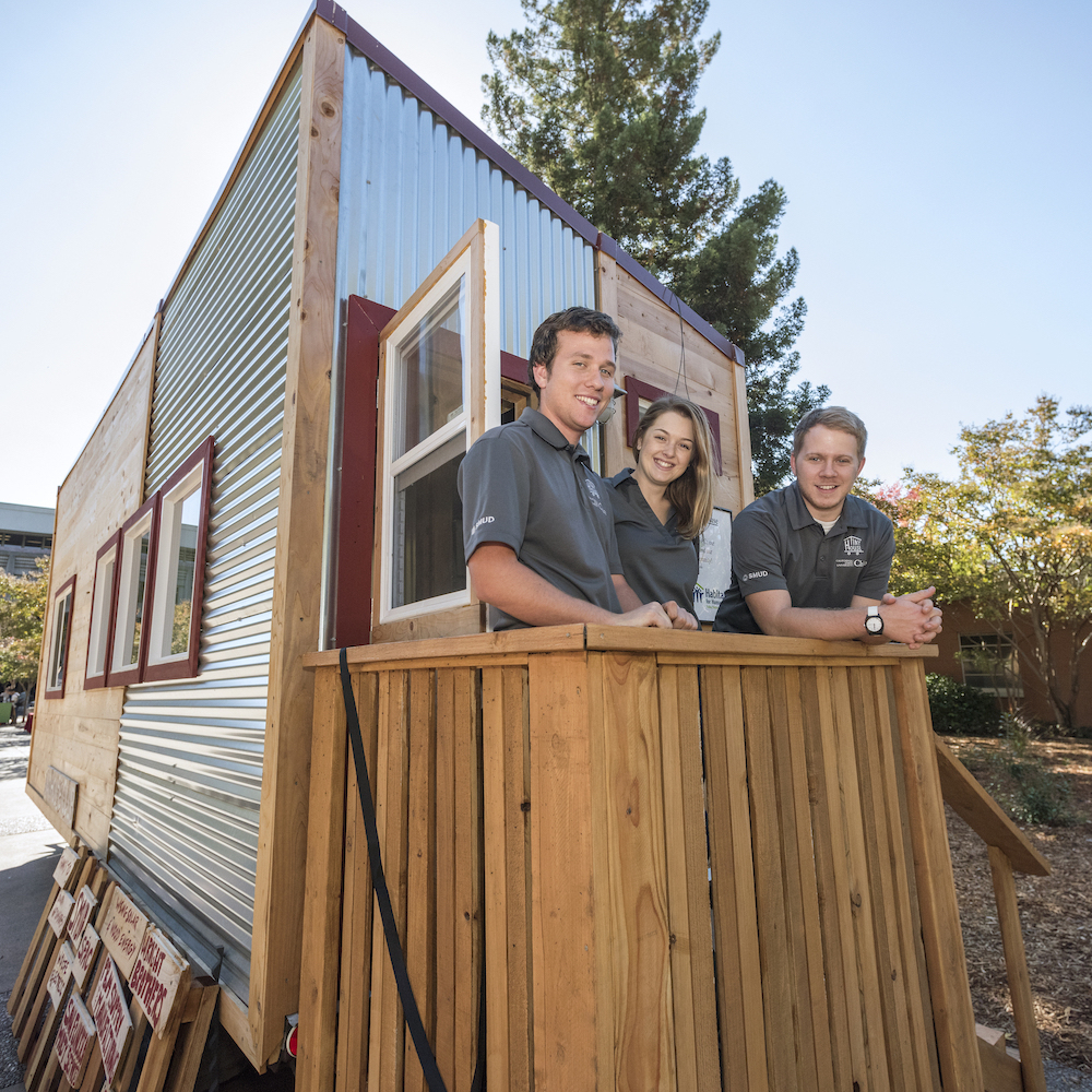 photo of students in front of tiny house