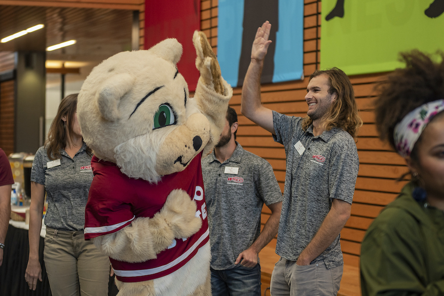 photo of Willie high-fiving staff