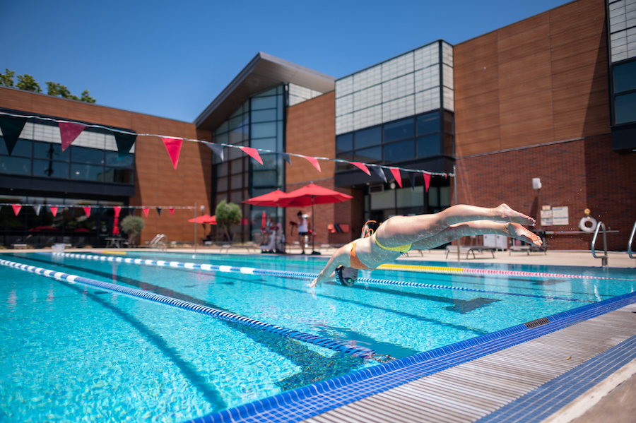 photo of girl diving into pool at the Wildcat Recreation Center