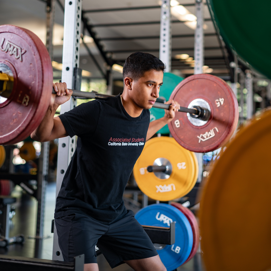 photo of student lifting weights