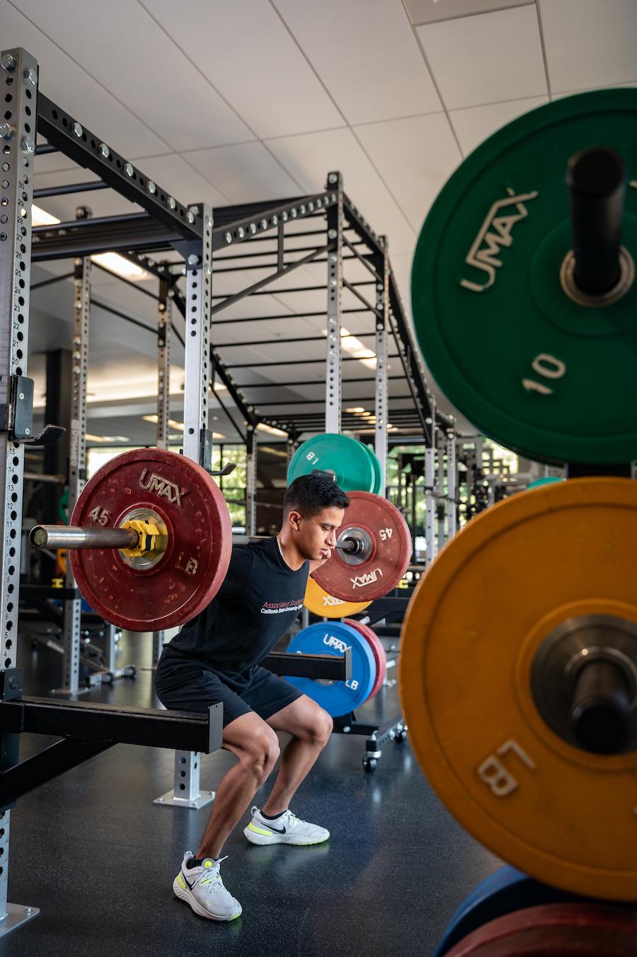 Photo of man lifting weights