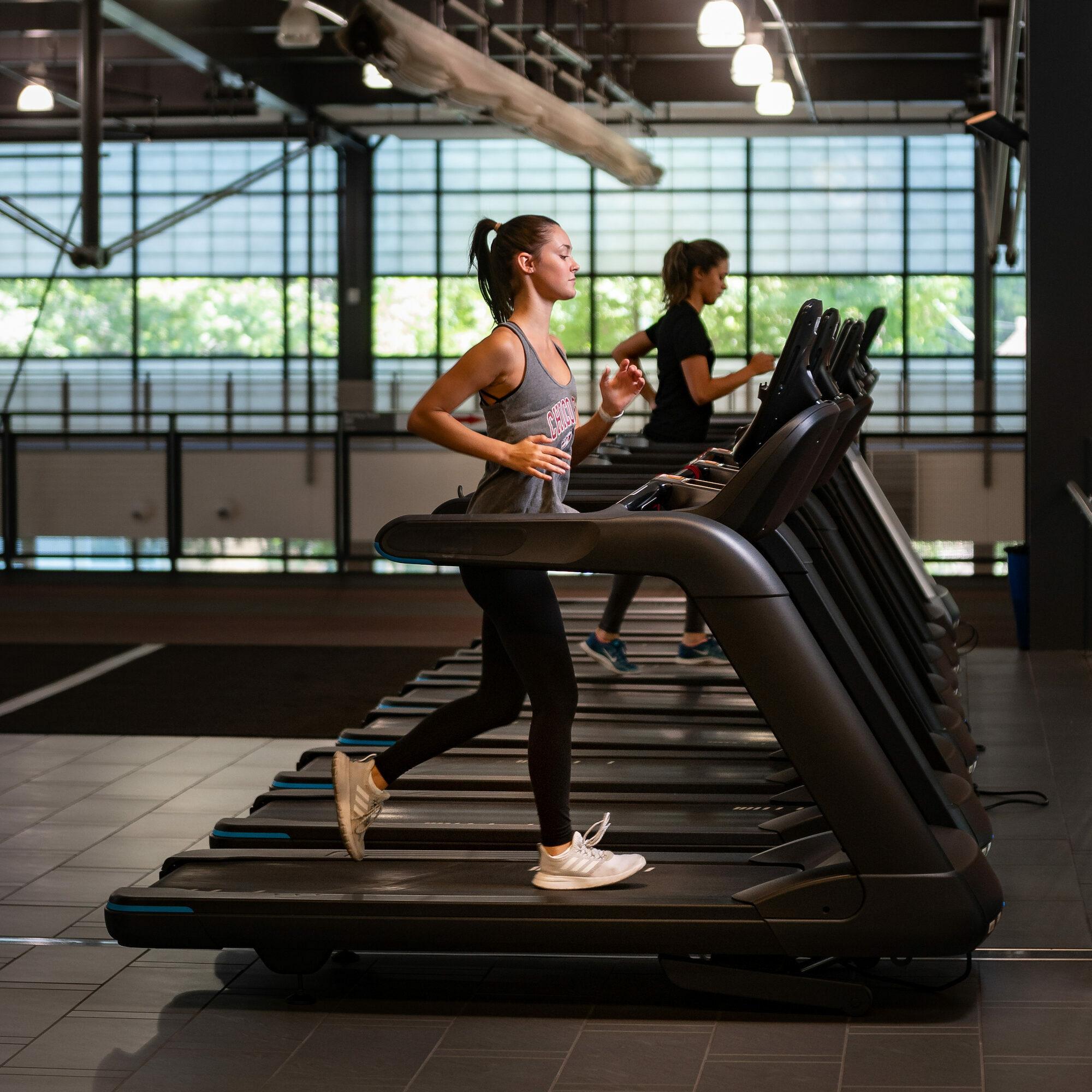 photo of woman running on treadmill