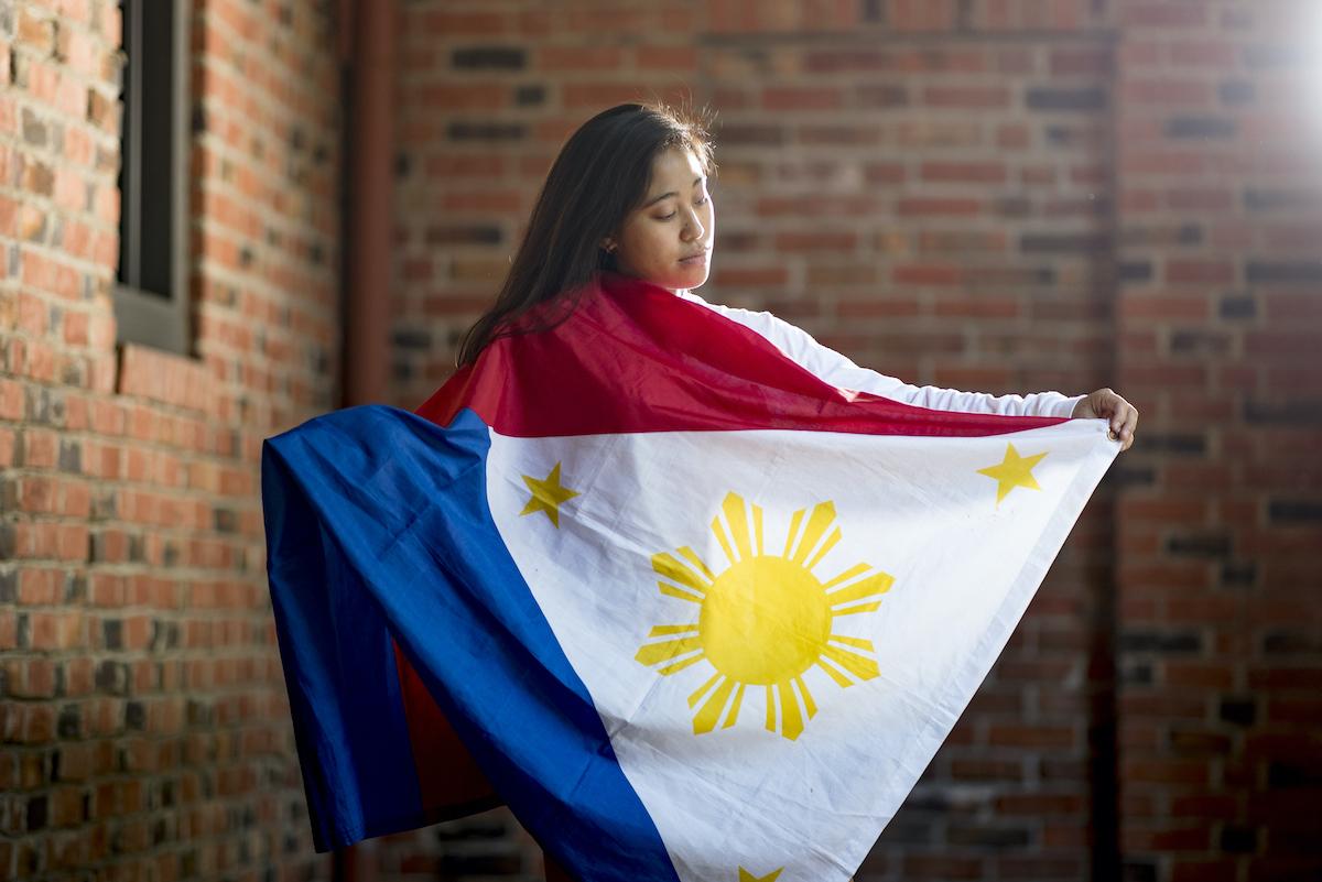 photo of student holding flag