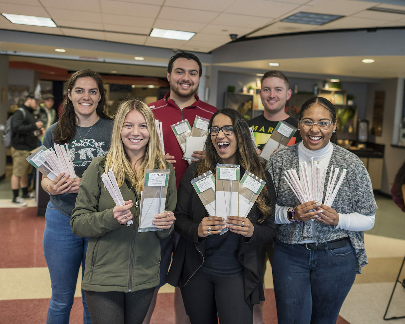 photo of students holding up reusable straws