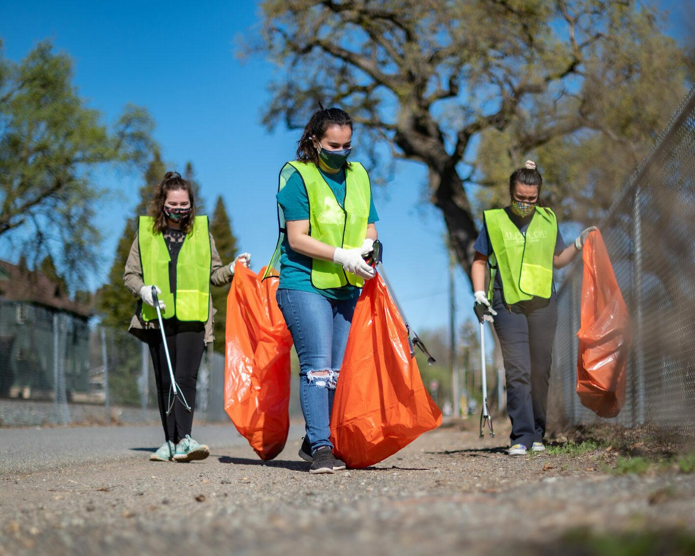 photo of group picking up trash